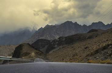 View or Karakoram Highway near Passu Pakistan. Passu is a small village on the Karakoram Highway, beside the Hunza River, some 15 kilometers from Gulmit, the Tehsil headquarters of Gojal in Gilgit.