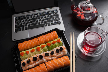 food photography art. sushi rolls set. japanese cuisine dinner delivery concept. Business lunch.