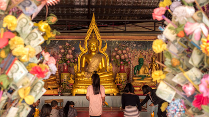 PATAYA THAILAND - January 14 - 2018:  [Buddha Chinnarat]Golden Buddhas seated at Wat Phra Yai temple in pataya. On January 14 - 2018 in Pataya,Thailand.