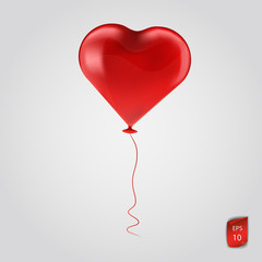 Flying Red balloon in the shape of a heart