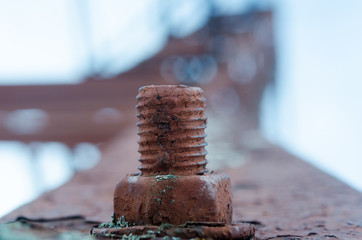 Corrosive rusted bolt with nut. Grunge industrial construction