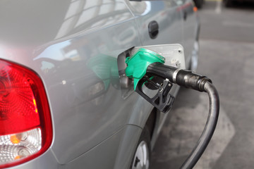 Filling up of  fuel at petrol station, closeup of equipment, power and energy