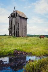 a broken mill in a field