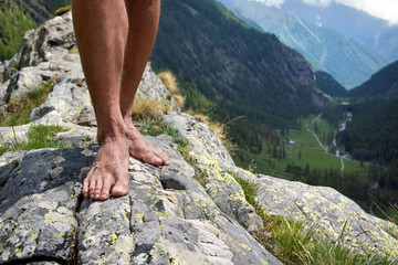 barefooted on big stone mountains