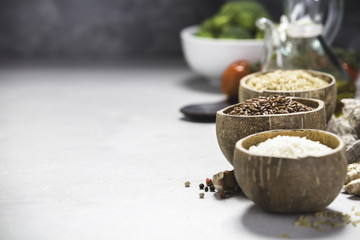 Assortment of different rice in bowls