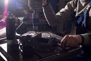 milling details on a metal-cutting machine. production at a small enterprise
