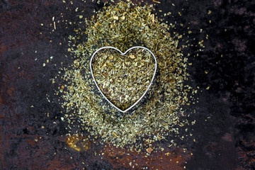 Heart made from yerba mate - dry leaves ready to cook mate tea.