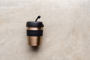 High angle view of reusable coffee cup on concrete background