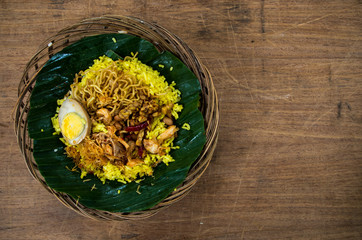NASI KUNING - typical Indonesian dish with copy space right.