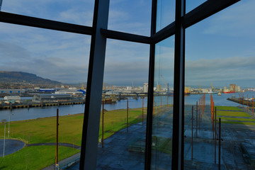 Framed window view of Titanic Dry dock area from inside museum