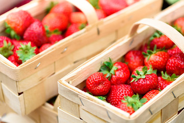 Handcrafted baskets with fresh strawberries.