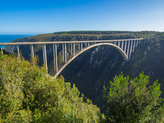 Garden Route - Famous Bloukrans Bridge with ocean in background and bungee jumpers, South Africa