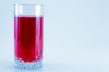 glass of fresh cranberry juice isolated on white background, top view