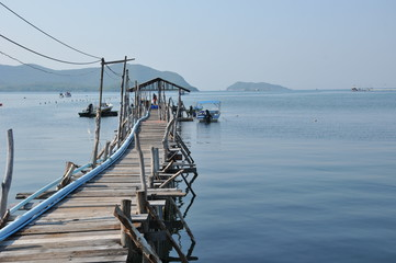 image of landscape blue sky cloudy with boat and jetty and sea.That place for vacation in Chonburi province , eastern Thailand. concept nature background vacation holiday tourism.