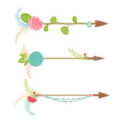 Vintage arrow set with floral element and feather