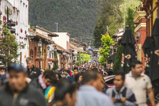 san cristobal street with tourist