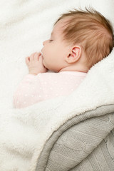 Portrait of adorable newborn baby girl sleeping
