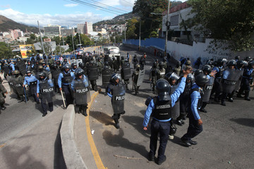 Security forces take positions to block demonstrators during a protest against the re-election of Honduras' President Hernandez in Tegucigalpa