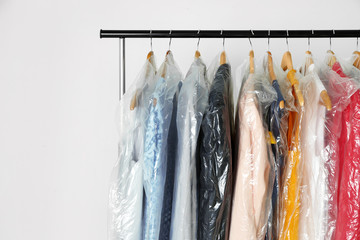 Hangers with clean clothes in laundry