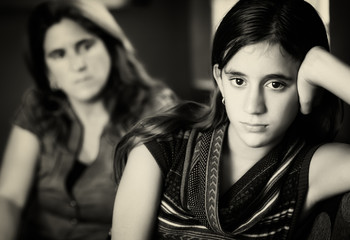 Defiant teenage girl and her worried mother