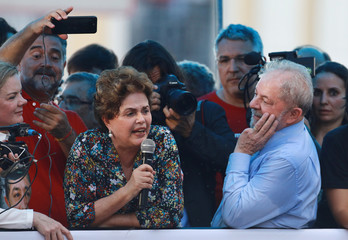 Former Brazilian president Luiz Inacio Lula da Silva looks at former president Dilma Rousseff during rally in support of his candidacy to the 2018 presidential race, in Porto Alegre