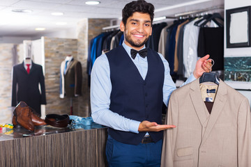 Man demonstrating suit in shop