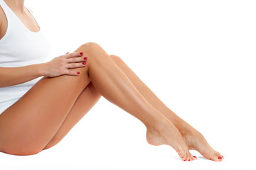 Long woman legs with smooth skin after depilation.
