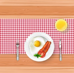 Breakfast food menu with fried egg and bacon on wooden table