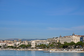 Cannes, France - view of the sea and beach in front of the Carlton International Hotel situated on the croisette boulevard in Cannes, France
