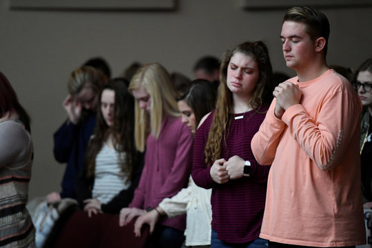 Students attend a prayer vigil for students killed and injured after a 15-year-old boy opened fire with a handgun at Marshall County High School, at Life in Christ Church in Marion