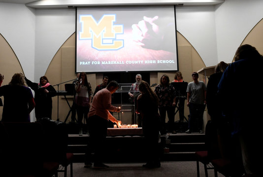 Parishioners light candles during a prayer vigil for students killed and injured after a 15-year-old boy opened fire with a handgun at Marshall County High School, at Life in Christ Church in Marion, Kentucky