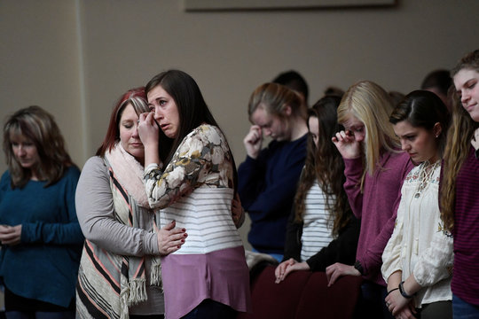 Students attend a prayer vigil for students killed and injured after a 15-year-old boy opened fire with a handgun at Marshall County High School, at Life in Christ Church in Marion, Kentucky