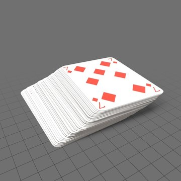 Blue playing cards with seven on top