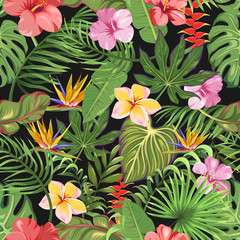 A seamless pattern with different tropical flowers and leaves. Exotic palms and flowers