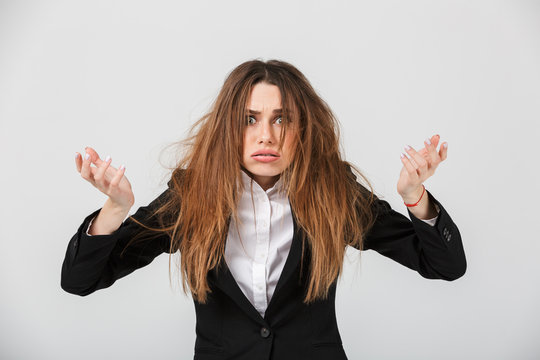Portrait of a frustrated businesswoman dressed in suit