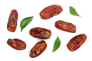 dry dates with green leaves isolated on white background. Top view. Flat lay pattern