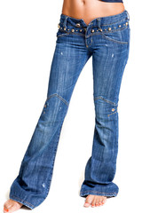 Fashionable jeans with flare on slender women legs