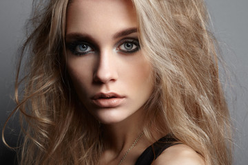 Portrait of young beautiful girl with blonde hair. Fashion photo Hairstyle. Make up. Vogue Style