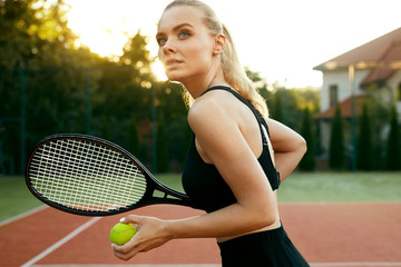 Sports Fashion. Beautiful Woman On Tennis Court.