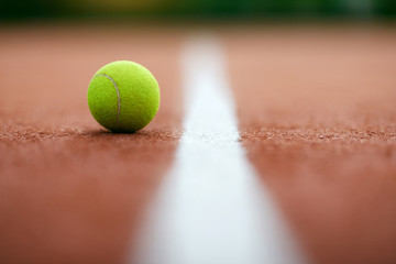 Sports. Close Up Shot Of Tennis Ball On Court.