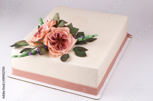 Rectangular Art Cake Decorated With Pink Flowers And Green Leaves