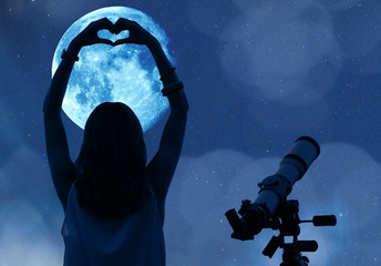 Girl holding a heart - shape with telescope, Moon and stars.