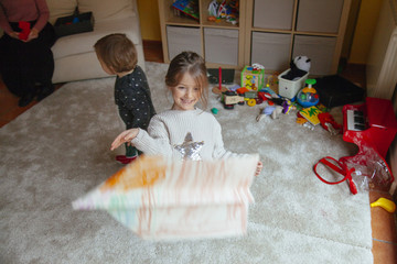 little girl playing at home with the family