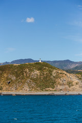 Lighthouse on cliffs near Wellington city, New Zealand