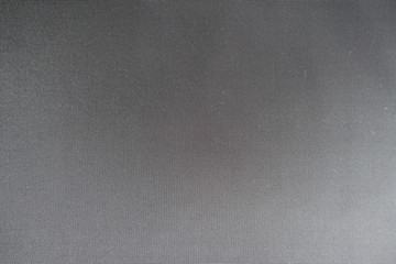 Texture of dark grey fabric from above
