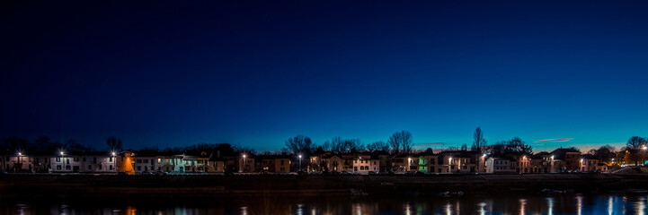 Fotomurales - riverfront homes at dusk - italian landscape panorama