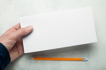 Empty blank envelopes on white table background. Template for branding identity. Top view.