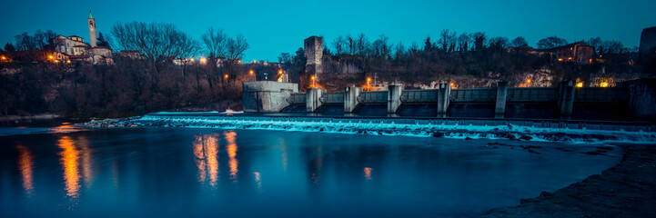 dam on the river at dusk - Adda river - italian landscape panorama