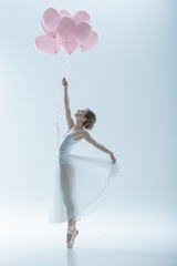 elegant ballet dancer in white dress with pink balloons, isolated on white