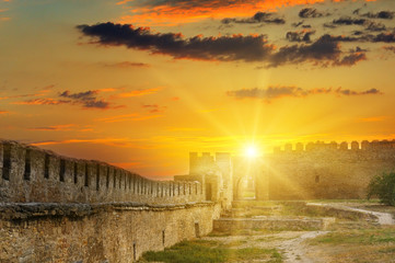 Sun rise over the fortress wall of a medieval fortress. Ukraine. Wall mural
